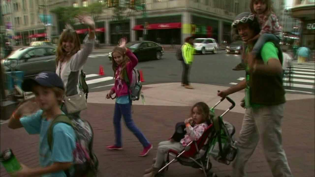A family of four from Argentina wave at the camera after traveling through 13 countries to visit Pope Francis in American Wednesday, Sept. 23,2015.